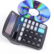 Stock Photo: DVD and calculator