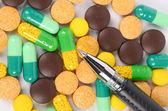 Medicine and pen — Stock Photo