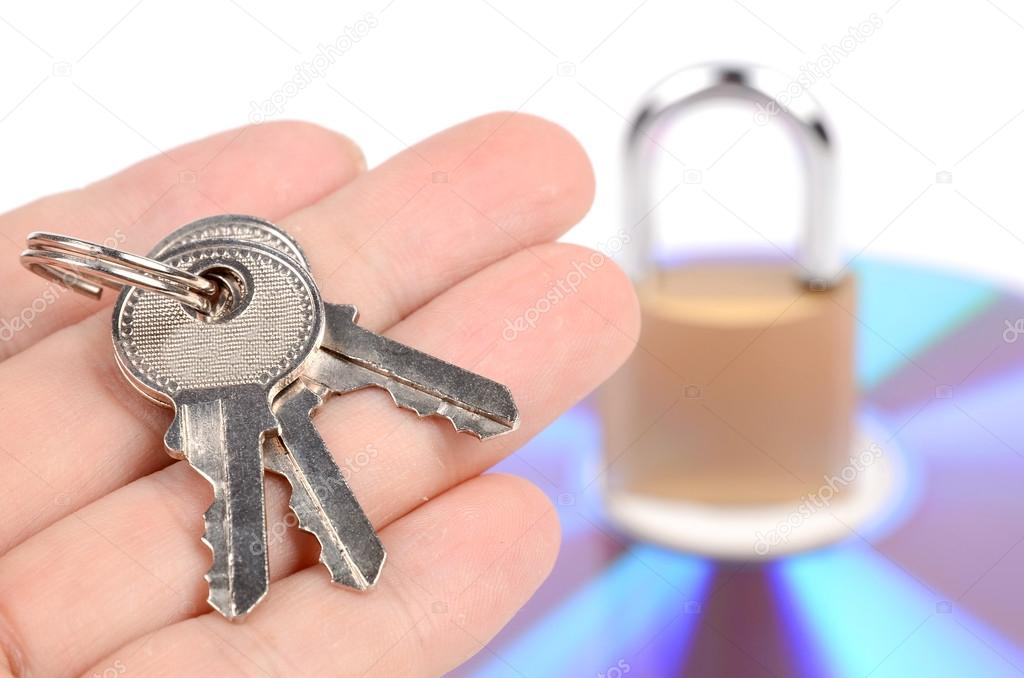 DVD and padlock with keys on white background — Stock Photo #12524947