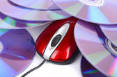 Computer mouse and DVD on white background — Stock Photo