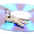 DVD and keys on white background — Stock Photo