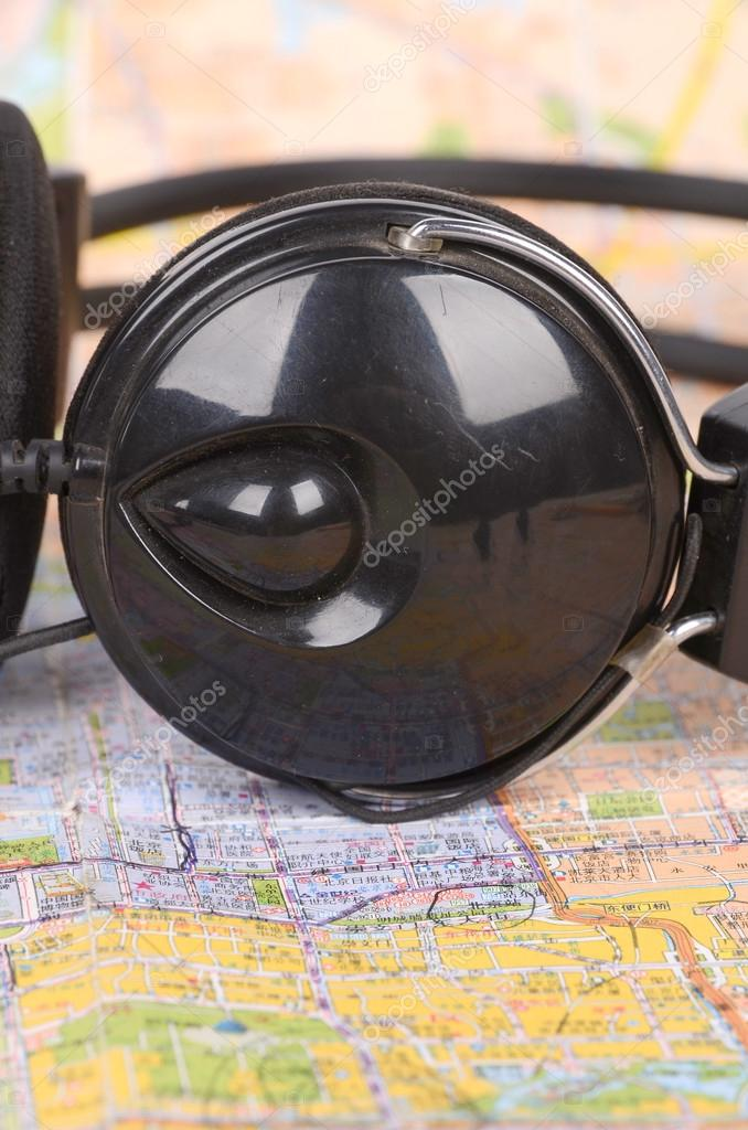Headphone and map  Stock Photo #12598453