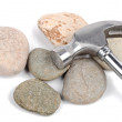 Hammer and stone on white background — Foto de Stock