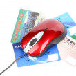 Computer mouse and credit card - Stock Photo