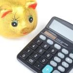 Piggy bank and calculator — Stock Photo