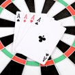Poker on dartboard — Stock Photo