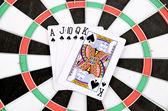 Poker on dartboard — Stock Photo