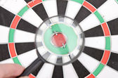 Magnifier and dartboard — Stock Photo