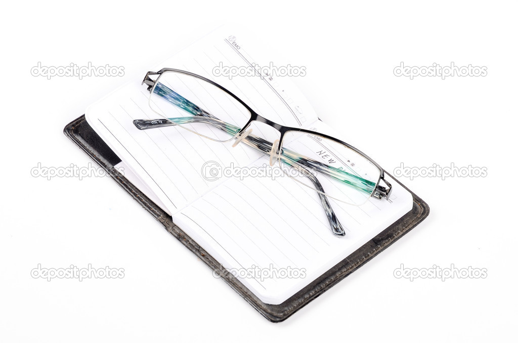 Notebook and glasses on white background — Stock Photo #12906868