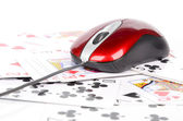 Poker and computer mouse — Stock Photo