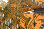 Computer mainboard and pen — Stock Photo
