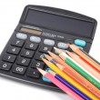 Calculator and color pencils — Stock Photo