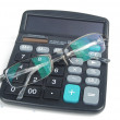 Calculator and glasses — Stock Photo