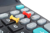 Calculator and push pin — Stock Photo
