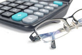 Calculator and glasses — Foto de Stock