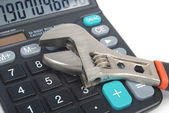 Wrench and calculator — Stock Photo