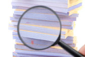 Documents and magnifier — Stock Photo