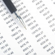 Financial data and pen — Stock Photo #13504284
