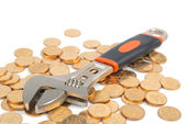 Wrench and coins — Stock Photo