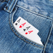 Poker and jeans - Stock Photo