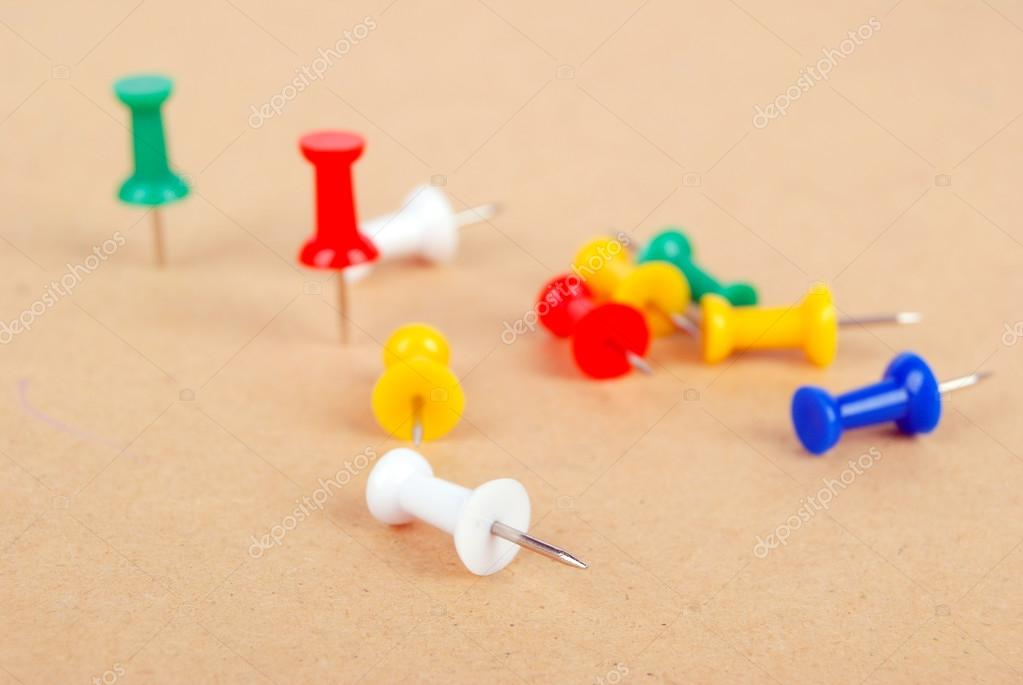 Push pin isolated on yellow background — Stock Photo #13560997