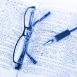 Book and pen with glasses — Stock Photo