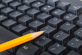 Computer keyboard and pencil — Stock Photo
