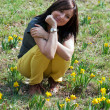 Young woman with daffodils — Stock Photo