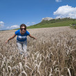 Young woman in wheat field, back is Spis castle — Stock Photo #12726854