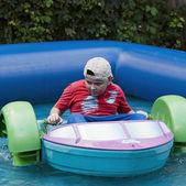Boy having fun with bumper boats — Stock Photo