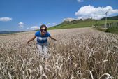 Young woman in wheat field, back is Spis castle — Stock Photo