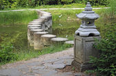 Decorative stone pagoda in green garden — Stock Photo