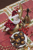 Christmas Doll with gingerbread brownies — Stock Photo