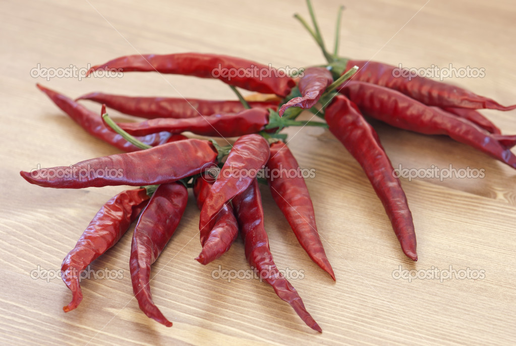 Red dry chillies on wooden background  Stock Photo #15822405