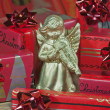 Gold angel with christmas gifts — Stock Photo