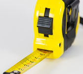 Roll-up tape measure on a white background — Stock Photo