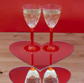 Champagne glasses in heart — Stock Photo