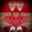Valentine champagne glasses in heart — Stock Photo
