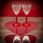 Valentine champagne glasses in heart — Stock Photo