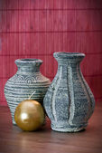 Vases of terracotta and yellow candle — Stockfoto