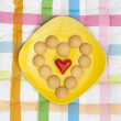Heart of biscuits with small red heart — Stock Photo