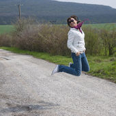 Jumping young woman — Stock Photo
