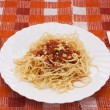 Portion of spaghetti with sauce — Stock Photo