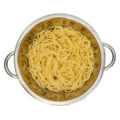 Spaghetti in a colander for pasta — Stock Photo