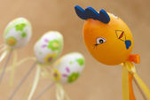 Easter rooster and three painted eggs — Stock Photo
