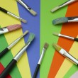 Brushes and colored paper - Stock Photo
