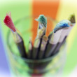 Painting brushes in a glass cup — Stock Photo