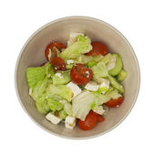 Bowl with fetta salad on a white background — Stock Photo