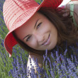 Beautiful woman with hat in a lavender field — Stock Photo