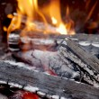 Charred wood in the fire — Stock Photo